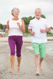 Active senior couple. Active and sporty senior couple at the beach Stock Images