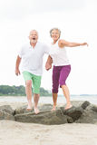 Active senior couple. Active and sporty senior couple at the beach royalty free stock photography