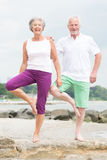 Active senior couple. Active and sporty senior couple at the beach Stock Photography