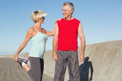 Active senior couple stretching before a jog Stock Photo