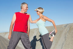 Active senior couple stretching before a jog Stock Images