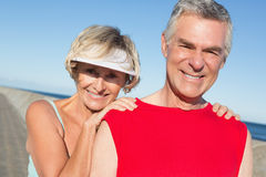 Active senior couple stretching before a jog. On a sunny day royalty free stock image
