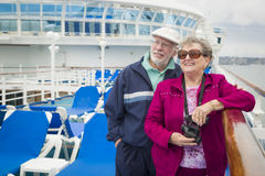 Active Senior Couple Using Binoculars on The Deck of a Cruise Ship Royalty Free Stock Photography