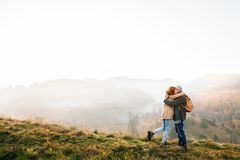 Senior couple on a walk in an autumn nature. Stock Images