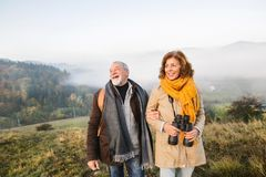 Senior couple on a walk in an autumn nature. Stock Photography