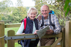 Active Senior Couple On Walk In Countryside Royalty Free Stock Images