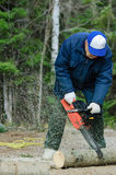 Active senior cutting a fallen tree royalty free stock photo