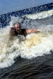 Active senior dives in waves Royalty Free Stock Photo