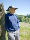 Active Senior Enjoying the Outdoors. Taking a break on a hike, this active senior takes in the view stock photography