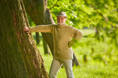 Active senior in a forest in summer Stock Photo
