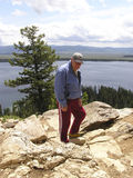 Active Senior  hiker 1. Senior proud man having reach the top of a 7200 feet altitude' mountain Stock Photography