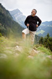 Active senior hiking in high mountains Stock Photos