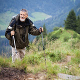 Active senior hiking in high mountains Royalty Free Stock Images