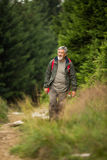 Active senior hiking in high mountains Royalty Free Stock Photo