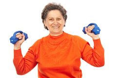 Active senior lady doing fitness. Active senior woman with dumbbells training, isolated on white Royalty Free Stock Photo