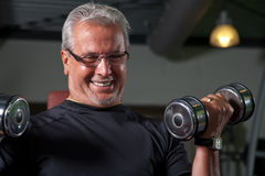 Active senior man. In the gym working out stock photography