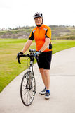 Active senior man. Standing by his road bicycle Stock Image