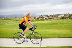 Active senior man. Riding a bicycle royalty free stock photo