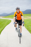 Active senior man. Riding a road bicycle Stock Photos