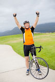Active senior man. Cheerful active senior man on bicycle with arms up Royalty Free Stock Images