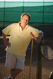 Active senior man. Portrait of an active senior man in his 70s on the tennis court Stock Photo