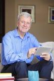 Active senior man with digital tablet Royalty Free Stock Photos