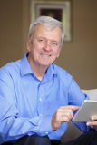 Active senior man with digital tablet Stock Photography