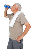 Active senior man drinking water. Over white background Stock Image