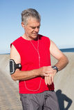 Active senior man jogging on the pier Royalty Free Stock Photography