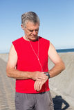 Active senior man jogging on the pier Stock Photos
