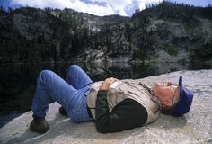 Active senior man napping on a rock Royalty Free Stock Photo