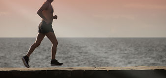 Active senior man running. The morning after the seaside Royalty Free Stock Image