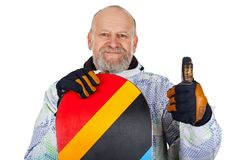 Active senior man with snowboard royalty free stock photography