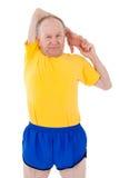 Active senior man. Stretching. Active senior man stretches before exercise Stock Image
