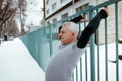 Senior Winter Stretching stock image