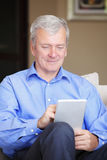 Active senior man with tablet Stock Photos