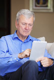 Active senior man with tablet Royalty Free Stock Photos