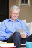Active senior man with tablet Royalty Free Stock Photography