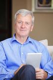 Active senior man with tablet Stock Images