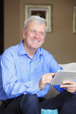 Active senior man with tablet Stock Photography