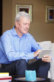 Active senior man with tablet Stock Image