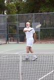 Active Senior Man - Tennis. Active senior man plays tennis for exercise and fun Stock Photos