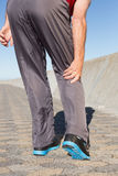 Active senior man touching his injured knee. On a sunny day Royalty Free Stock Photo