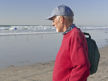 Active senior man walking by the sea Stock Photo