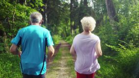 Active senior man and woman running for better fitness