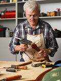 Active senior man working Stock Images