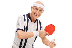 Active senior playing ping-pong Stock Images