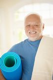 Active senior in sportswear. Holding polyfoam, smiling at camera Stock Photo