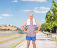 Active senior standing on a sidewalk Stock Photo