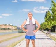 Active senior standing on a sidewalk Stock Photo